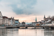 Switzerland, Zurich, City With Limmat River, Houses On Riverfront And Bell Towers In Background