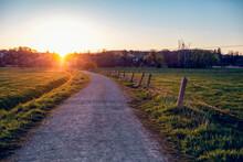 Germany, Bavaria, Neusaess, Countryside Dirt Road At Sunset