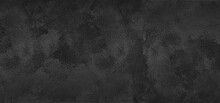 Black Plaster Texture. Textured Concrete Wall Wide Gloomy Backdrop. Dark Grey Rough Surface Abstract Grunge Background