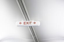 Exit Sign On White Airplane Ceiling