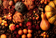 Autumn Composition On A Rustic Wooden Background. Decorative Pumpkins, Various Leaves, Pine Cones, Nuts. Orange, Yellow, Red  And Brown Aesthetics.