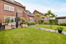 Lawn In Yard Of Brick House