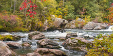 View Of A Stormy Mountain River In September At The Wildcat Falls. Red Autumn Leaves Hang Over The River. Merrimack, New Hampshire, USA