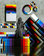 Abstract Human Statue Sitting With Digital Color Block Forms