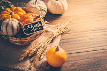 Thanksgiving - Still Life With Pumpkins, Ears And Autumn Leaves On Wooden Background