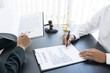 Leinwandbild Motiv law,libra scale and hammer on the table, 2 men are dealing and signing contract, law matters determination
