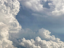 Dense White Clouds Contrast With Grey Couds
