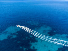 Aerial Drone View Of Motor Boat At Blue Sea. Motorboat In The Tropical Waters At Summer. Tourists On A Motor Boat Trip. Tourists Ride High-speed Boat On The Water.