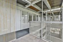 Corridor With Door And Windows Against Fences