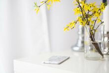 Beautiful Bouquet Of Yellow Flower And White Smartphone On A Desk In The Office. (selective Focus).