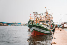 Fishing Boat Tied To A Pier On A  Gloomy Day In Indonesia