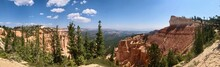 Bryce Canyon National Park In Utah.Rocky Mountains Erode And Color A Variety Of Landscapes. Red Rock Surface, Green Forest, Wide Shot.