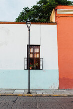 Street View Of A Rustic Colorful Building.