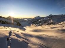 Golden Sunrise Over Aletsch Glacier In The Alps.