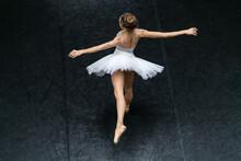 Female Ballet Dancer Posing Inside Dance Hall