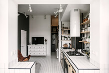 White Framed Perspective Of A Kitchen And Living Room