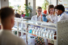 Lab Workers Analyze Contents In Test Tube.