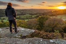 Man Looking At Sunrise From A Scenic View In The Yorkshire Dales