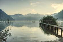 Jetty And Reeds On Lake Lugano Near Lavena Ponte Tresa