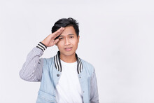 A Man Makes A Casual Salute Gesture. With A Cocky Smile. Isolated On White Background.