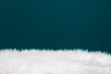 Texture Of Fluffy Fur On Blue Background.