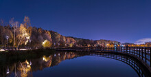 Moscow. October 15, 2021. Golden Autumn In Meshchersky Park. Night Landscape With Reflektion Of The Trees And Bridge In The Pond.