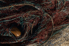 Close-up Of Fishing Nets. Background Image Of Fishing And Overfishing Of Fish Stocks