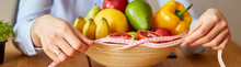 Close Up Of Hand Nutritionist, Dietitian Measuring Bowl With Healthy Vegetables And Fruits