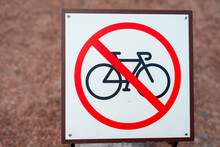 Sign Of No Bikes On A Fence Near House.