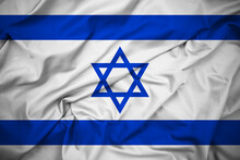 Close Up Flag Of Israel, Front View. Blue Star Of David Between Two Horizontal Blue Stripes On White Background. Shiny Silk Fabric. Detailed Texture.