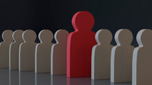 Red Large Wooden Human Figure Stands Out From The Formation Of Identical Small White Wooden Human Figures On A Gray Background. Leadership Concept. Not Like Everyone Else. 3D Rendering