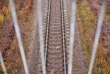 View Of The Railway Through The Bridge Fence