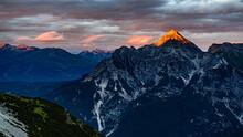 An Orange Peak Of Serles Mountain From Sun During Sunset In Stubai Alps In Austria.