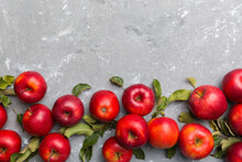 Many Red Apples On Colored Background, Top View. Autumn Pattern With Fresh Apple Above View With Copy Space For Design Or Text