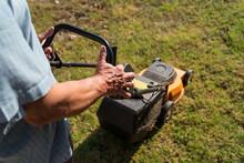 Man Mowing Lawn In Summer