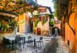 Leinwanddruck Bild - Charming old narrown streets of Italian villages. Malcesine, Garda lake, Italy. Autumn colors, cosy street bars