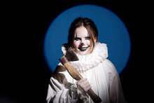 A Creepy Emotional Portrait Of A Woman In A Clown Mask With An Axe In Her Hands. Halloween.