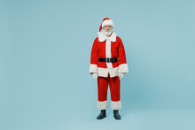 Full Body Serious Old Santa Claus Man 50s In Christmas Hat Red Suit Clothes Posing Look Camera Isolated On Plain Blue Background Studio. Happy New Year 2022 Celebration Merry Ho X-mas Holiday Concept.