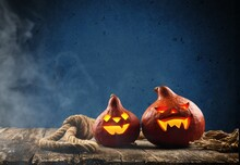 A Scary Pumpkin Lantern With Evil Grin For Halloween Concept.