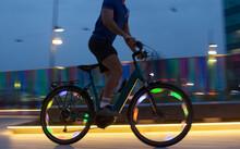 Man Riding Illuminated Bike At Night