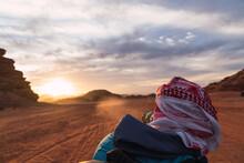 Man With Camera Between Sand Lands In Desert