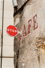 Vintage Cafe Shop Sign And Stop Sign On Old  Building
