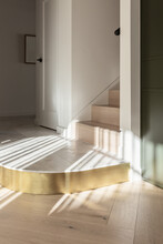 A Curved Marble And Brass Step