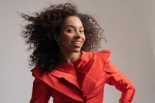 Studio Portrait Of Black Woman In Red Dress.