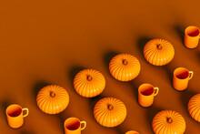 Pumpkins And A Mug On Brown Background