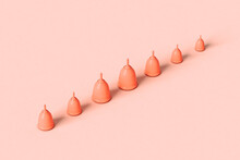 Menstrual Cups On Pink Crossing The Frame
