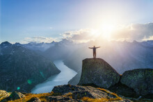 Man Standing On Mountain Top