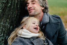 Happy Father Hugging Daughter In Park