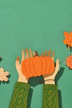 Pumpkin In Female Hands