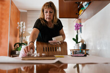 Craftswoman Packing Porcelain Flowers